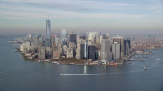 AX120_121 - 6K stock footage aerial video of approach Lower Manhattan and Battery Park in Autumn, New York City