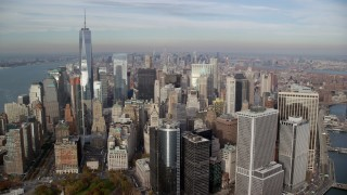 AX120_124 - 6K stock footage aerial video approach Lower Manhattan skyscrapers in Autumn, New York City