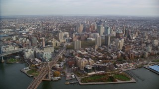 AX120_129 - 6K stock footage aerial video approach skyscrapers in Autumn, Brooklyn, New York City