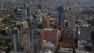 AX120_132 - 6K stock footage aerial video approach Brooklyn skyscrapers by Flatbush Ave in Autumn, New York City