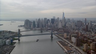 AX120_141 - 6K stock footage aerial video of Brooklyn Bridge, Manhattan Bridge and Lower Manhattan, New York City