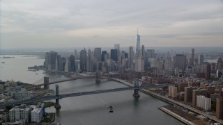 AX120_142 - 6K stock footage aerial video of Lower Manhattan skyscrapers by the Brooklyn and Manhattan Bridges, New York City