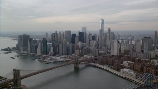 AX120_144 - 6K stock footage aerial video fly over Manhattan Bridge to approach Lower Manhattan, New York City