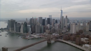 AX120_145 - 6K stock footage aerial video approach Brooklyn Bridge and Lower Manhattan skyline, New York City