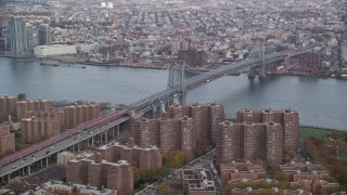 AX120_151 - 6K stock footage aerial video approach the Williamsburg Bridge in Autumn, New York City