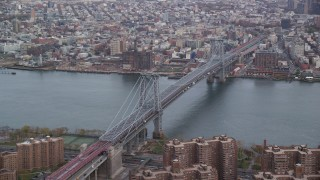 AX120_152 - 6K stock footage aerial video approach and orbit the Williamsburg Bridge in Autumn, New York City