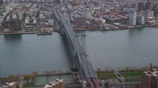 AX120_153 - 6K stock footage aerial video orbit the Williamsburg Bridge in Autumn, New York City