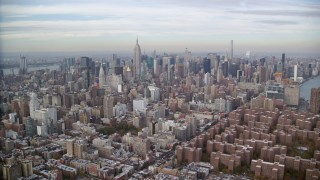 AX120_154 - 6K stock footage aerial video approach Midtown from East Village in Autumn, New York City