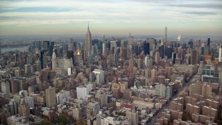 AX120_154E - 6K stock footage aerial video approach Midtown from East Village in Autumn, New York City