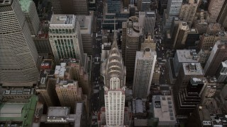 AX120_161 - 6K stock footage aerial video tilt to a bird's eye view of the Chrysler Building in Midtown, New York City