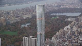 AX120_162 - 6K stock footage aerial video orbit top of 432 Park Avenue in Midtown in Autumn, New York City