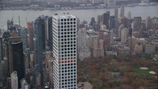 AX120_163 - 6K stock footage aerial video orbit around 432 Park Avenue in Autumn, Midtown Manhattan, New York City