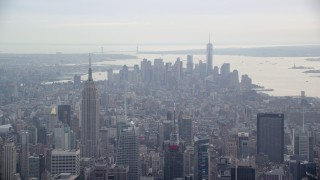 AX120_169 - 6K stock footage aerial video of the Empire State Building and Lower Manhattan, New York City