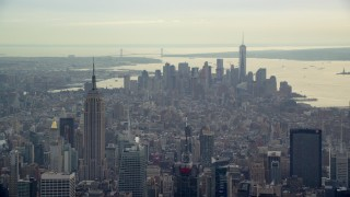 AX120_169E - 6K stock footage aerial video of the Empire State Building and Lower Manhattan, New York City