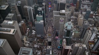 AX120_176 - 6K stock footage aerial video orbit Times Square and Broadway in Midtown, New York City
