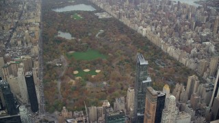 AX120_181 - 6K stock footage aerial video orbit Central Park in Autumn, New York City