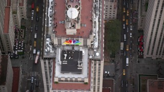 AX120_187 - 6K stock footage aerial video orbit ice rink and skyscraper at Rockefeller Center, Midtown, New York City