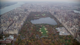 AX120_195 - 6K stock footage aerial video approach the reservoir and The Met in Central Park, New York City
