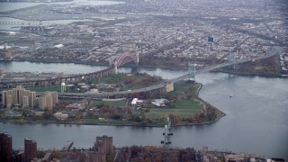 AX120_201 - 6K stock footage aerial video of Robert F. Kennedy and Hell Gate Bridges on Wards Island, New York City