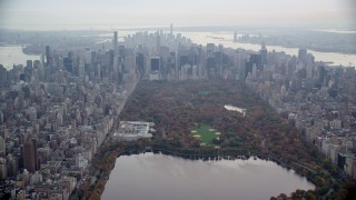AX120_202 - 6K stock footage aerial video of The Met, Central Park and Midtown skyscrapers in New York City