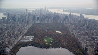 AX120_203 - 6K stock footage aerial video of flying by The Met in Central Park and Midtown skyscrapers in New York City