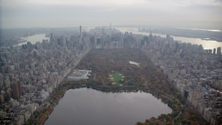 AX120_211 - 6K stock footage aerial video fly over Central Park toward The Met and Midtown in Autumn, New York City