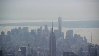 AX120_225 - 6K stock footage aerial video of the top of the Empire State Building and Lower Manhattan, New York City