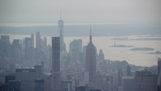 AX120_226 - 6K stock footage aerial video of Empire State Building, Freedom Tower and 432 Park Avenue in New York City