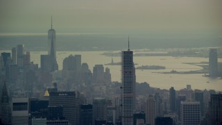 AX120_227 - 6K stock footage aerial video of 432 Park Ave, Empire State Building and Freedom Tower in New York City