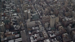 AX120_231 - 6K stock footage aerial video fly over apartment buildings and streets on Upper East Side, New York City