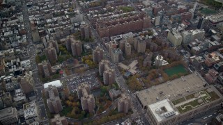 AX120_238 - 6K stock footage aerial video approach Penn South apartment buildings in Chelsea in Autumn, New York City