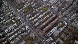 AX120_239 - 6K stock footage aerial video of a bird's eye view of Chelsea apartment buildings in Autumn, New York City