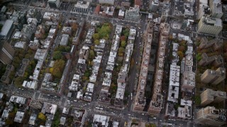 AX120_240 - 6K stock footage aerial video of a bird's eye orbit of apartment buildings and streets in Chelsea in Autumn, New York City