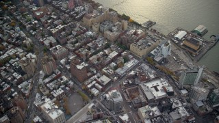 AX120_241 - 6K stock footage aerial video of office and apartment buildings in Greenwich Village in Autumn, New York City