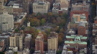 AX120_243 - 6K stock footage aerial video orbit Washington Square Park in Autumn, Greenwich Village, New York City