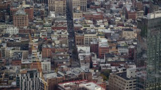 AX120_244 - 6K stock footage aerial video orbit apartment buildings and busy street In Soho, New York City