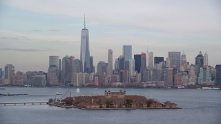 AX120_259 - 6K stock footage aerial video orbit Ellis Island and Lower Manhattan skyline in Autumn, New York City