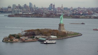 AX120_262 - 6K stock footage aerial video orbit Liberty Island and Statue of Liberty in Autumn, New York