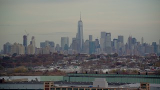 AX120_274 - 6K stock footage aerial video of Freedom Tower and Lower Manhattan skyline seen from Jersey City in Autumn
