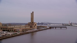 AX121_001 - 6K stock footage aerial video approach waterfront factory with smoke stacks at twilight, Kearny, New Jersey