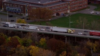 AX121_008 - 6K stock footage aerial video track ambulance on freeway at twilight in Autumn, Bayonne, New Jersey