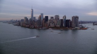 AX121_017 - 6K stock footage aerial video of a wide orbit of Battery Park and Lower Manhattan skyline at twilight, New York City