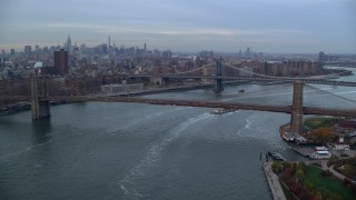 AX121_023 - 5.5K stock footage aerial video approach the Brooklyn and Manhattan Bridges at twilight in New York City