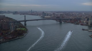 AX121_026 - 6K stock footage aerial video of approaching the Williamsburg Bridge at twilight in New York City