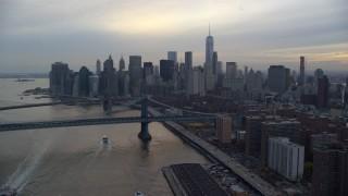 AX121_027E - 5.5K stock footage aerial video of the Manhattan Bridge and Lower Manhattan skyline at twilight in New York City