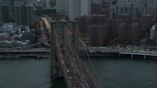 AX121_040 - 5.5K stock footage aerial video orbit Brooklyn Bridge at twilight in New York City