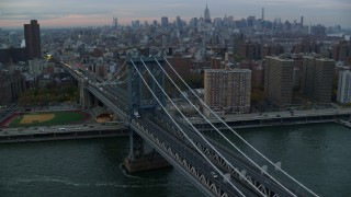 AX121_041 - 6K stock footage aerial video orbit Manhattan Bridge at twilight in New York City