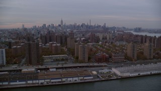 AX121_042 - 6K stock footage aerial video of public housing buildings on Lower East Side at twilight in New York City