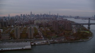 AX121_043 - 6K stock footage aerial video of Lower East Side projects and Williamsburg Bridge at twilight in New York City