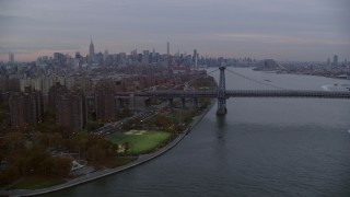 AX121_044 - 6K stock footage aerial video of projects on Lower East Side and Williamsburg Bridge at twilight in New York City